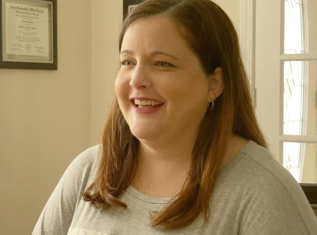 Family taking dog on a walk