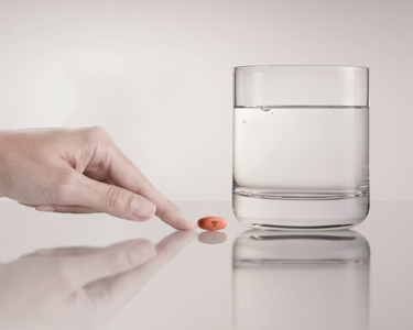 Glass With Pill